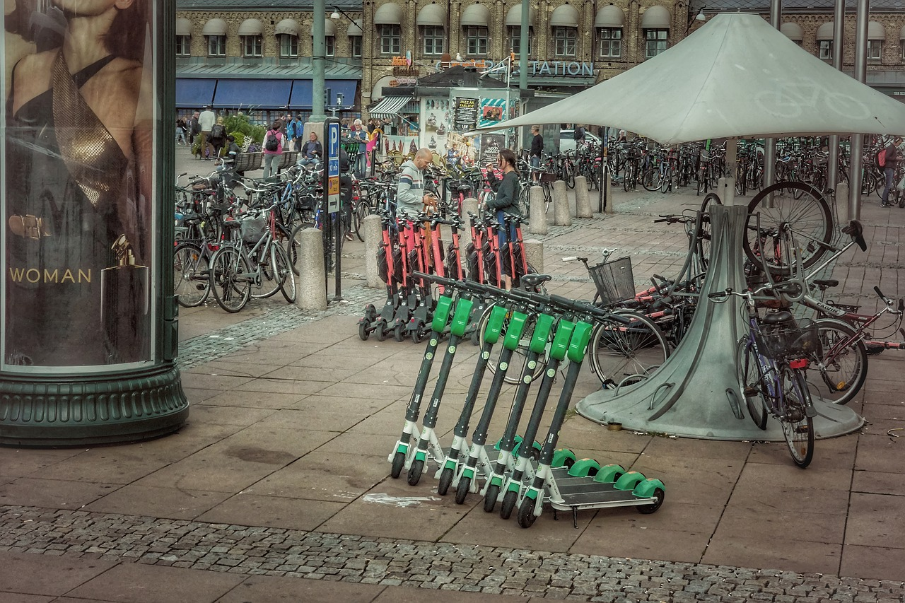 Electric scooters parked in a row